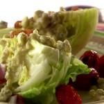 A wedge salad is served.
